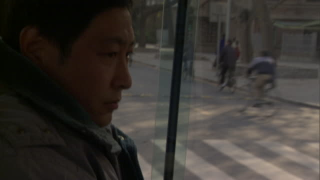 cu tu man driving qinqua university fuel cell bus, beijing, china - bus driver stock videos & royalty-free footage