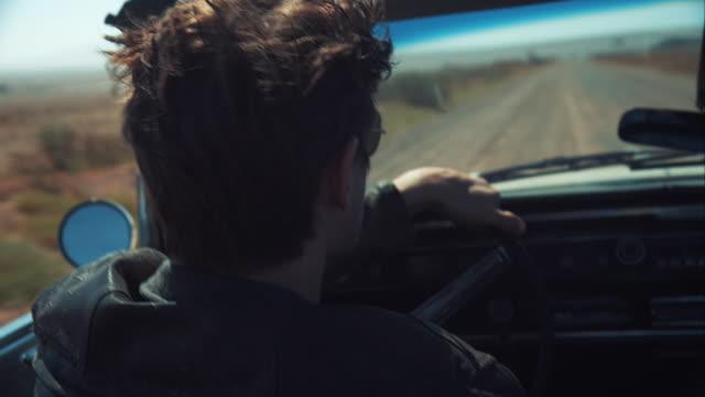 man driving retro car on dirt road - man convertible stock videos & royalty-free footage
