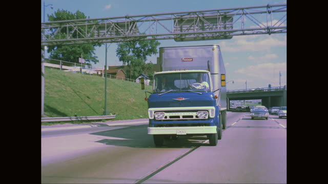 ws ts man driving truck on road / united states - 1960 stock-videos und b-roll-filmmaterial