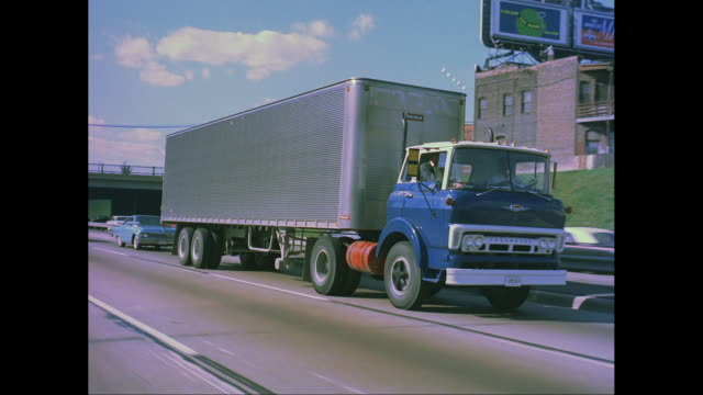 WS TS Man driving truck on road / United States