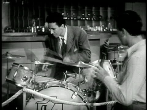 b/w 1940 man drumming as artie shaw plays clarinet in foreground / feature film - clarinet stock videos & royalty-free footage