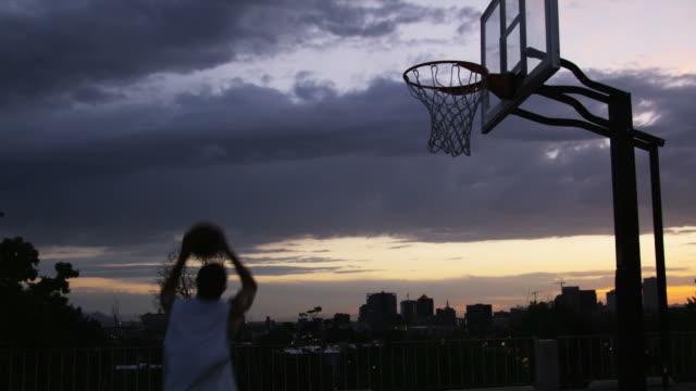 WS Man dunking a basketball / Salt Lake City, Utah, USA.