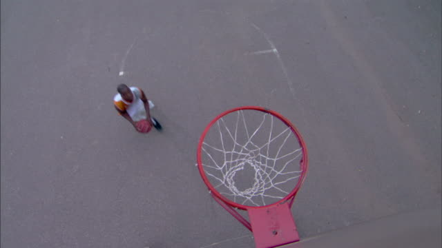 man dunking basketball into hoop - see other clips from this shoot 1281 stock videos and b-roll footage