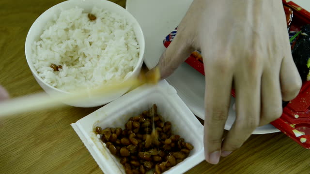 cnapfoo344 - man eat and mix natto - fermenting stock videos and b-roll footage