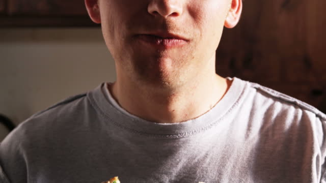 man eating a sandwich