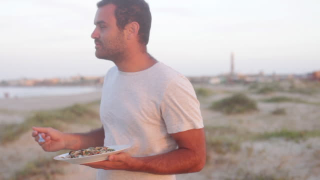Man eating at the beach