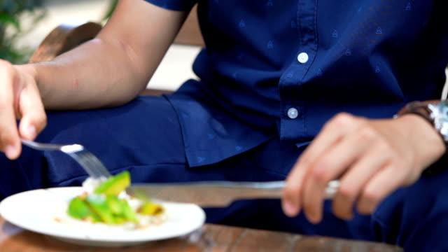 slo mo - man eating avocado with rice cracker - avocado salad stock videos & royalty-free footage