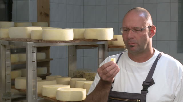 ms man eating cheese / mannebach, rhineland-palatinate, germany - チーズ点の映像素材/bロール