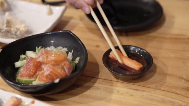 man eating crab stick with wasabi sauce. - wasabi stock videos and b-roll footage