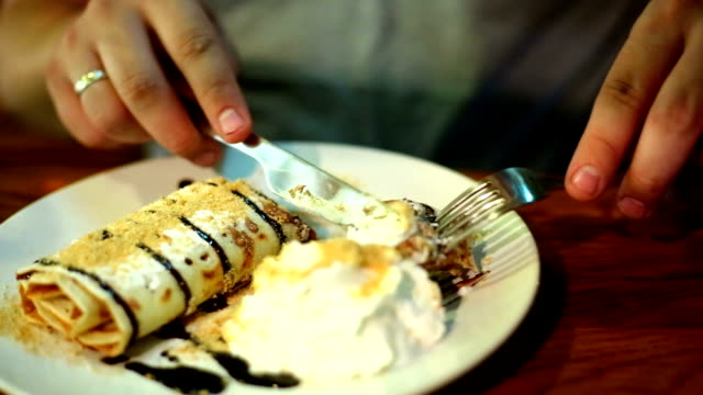 man eating dessert in a restaurant - pancake stock videos & royalty-free footage