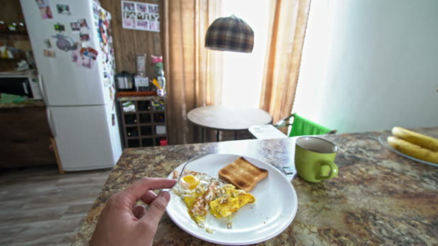 pov of man eating eggs and toasted bread - breakfast stock videos and b-roll footage
