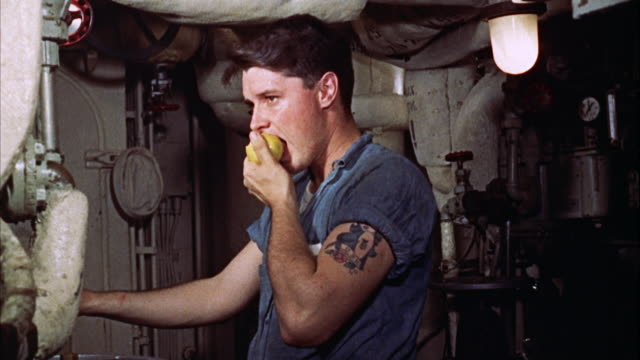 man eating fruit while working - control stock videos and b-roll footage