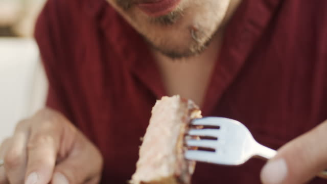 man eating grilled salmon and vegetables in a restaurant - fish stock videos & royalty-free footage