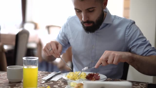 man eating ham and eggs breakfast - over eating stock videos & royalty-free footage