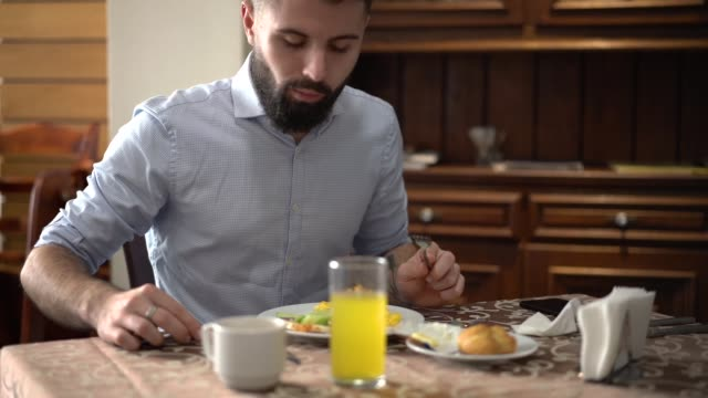 man eating light breakfast - one man only stock videos & royalty-free footage