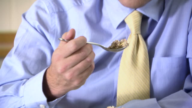 man eating muesli - masticare video stock e b–roll