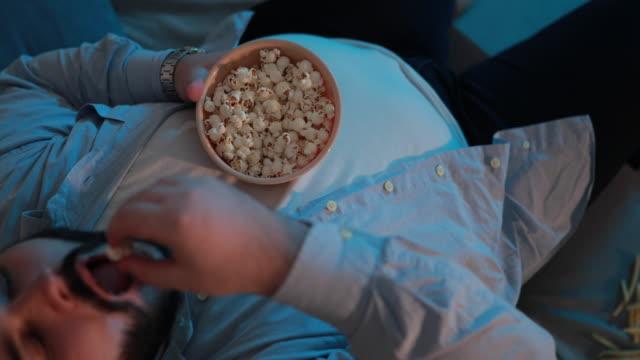 man eating popcorn - popcorn stock videos & royalty-free footage