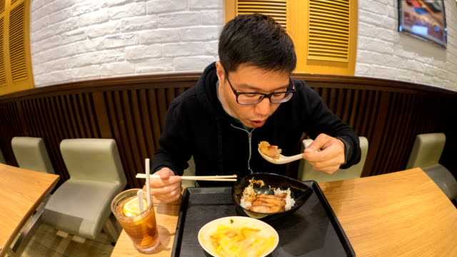 4k t/l man eating rice with pork, hong kong food set - food court stock videos and b-roll footage