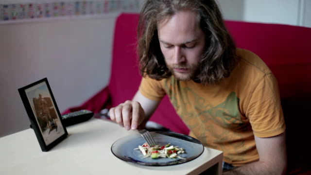 man eating salad - displeased stock videos and b-roll footage