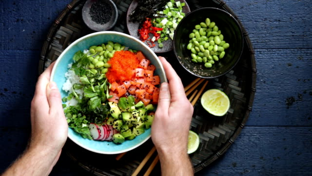 Man eating Salmon poke bowl