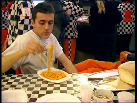 MS Man eating spaghetti before Battle of Oranges / Ivrea, Torino, Italy / AUDIO
