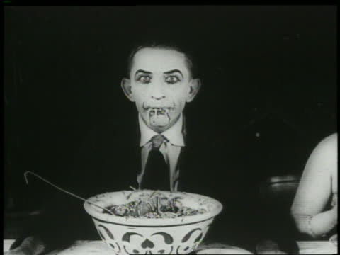 B/W 1920 man (Larry Semon) eating spaghetti + makes face / finds boot in bowl