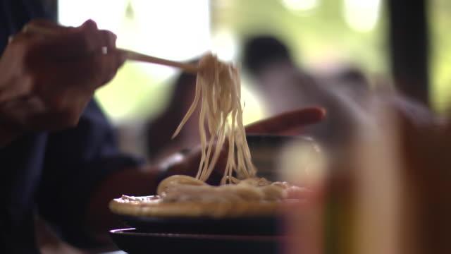 a man eating zarusoba noodle, nagano, japan - soba stock videos & royalty-free footage