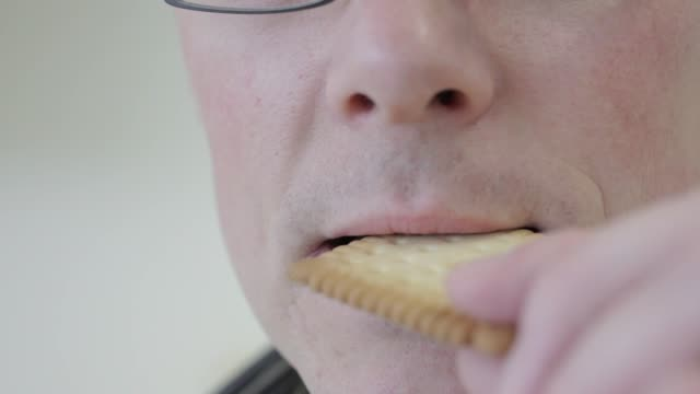 man eats sample butter biscuit during testing at givaudan sa flavor research laboratory inside the companys headquarters in dubendorf givaudan sa... - smelling stock videos & royalty-free footage