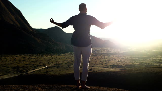 man embracing african nature. opening arms - tutti i tipi di top video stock e b–roll