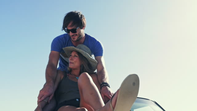 man embracing woman - flip flop stock videos and b-roll footage