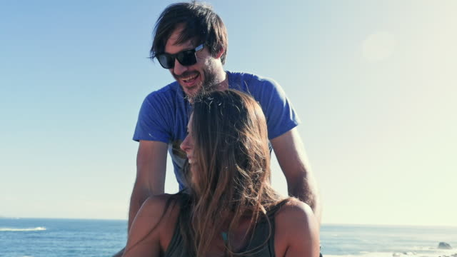 : man embracing woman - sonnenbrille stock-videos und b-roll-filmmaterial