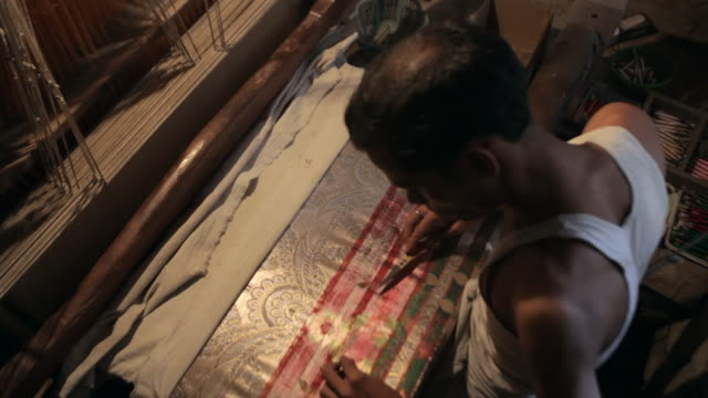 MS HA Man embroidering sari with gold thread / India