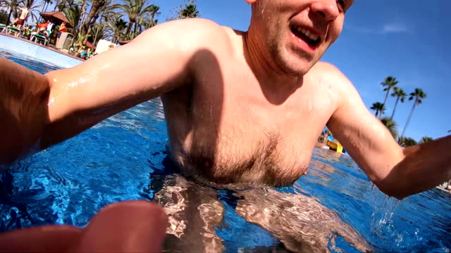 pov man emerging from the swimming pool in 4k slow motion - caucasian appearance stock videos & royalty-free footage