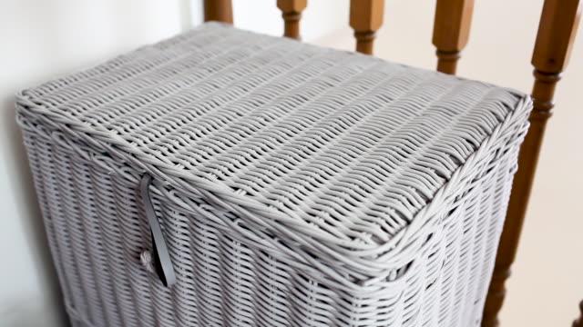 man emptying laundry bin into washing basket - hamper stock videos & royalty-free footage
