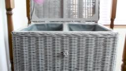 Man emptying laundry bin into washing basket