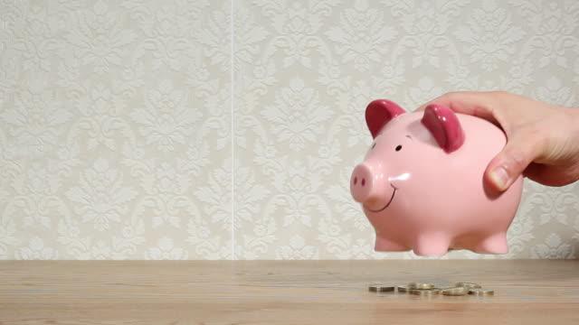 man emptying piggy bank - shaking stock videos & royalty-free footage
