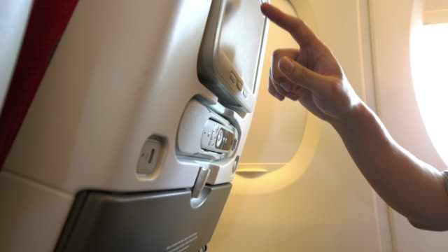 Man enjoying entertainment stuff on the plane