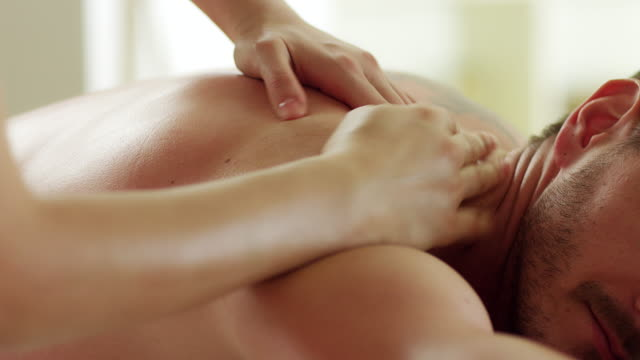 man enjoying massage - massage stock videos & royalty-free footage