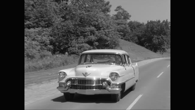 vidéos et rushes de ws pov man enjoying road trip / united states - 1955