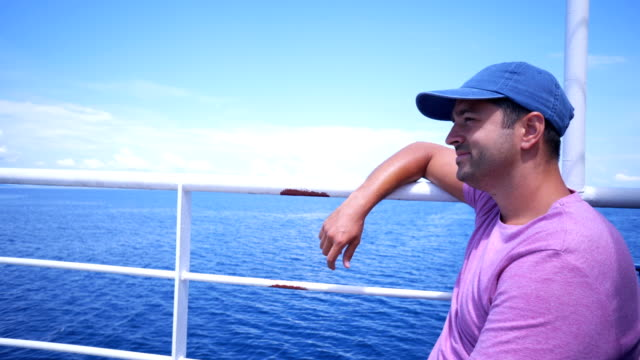 Man enjoying the amazing view from cruise ship