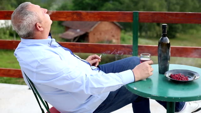 Man enjoying the great view into the distance with a glass of wine
