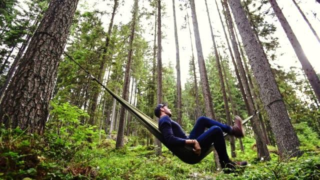 man enjoyment on the hammock - hammock stock videos & royalty-free footage