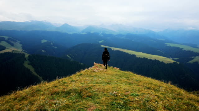 man enjoys beautiful landscape of mountain - horizon over land stock videos & royalty-free footage