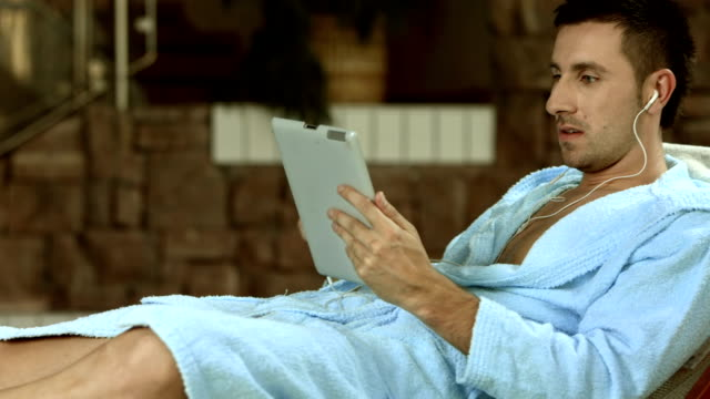 hd: man enjoys music by the pool - bathrobe stock videos & royalty-free footage