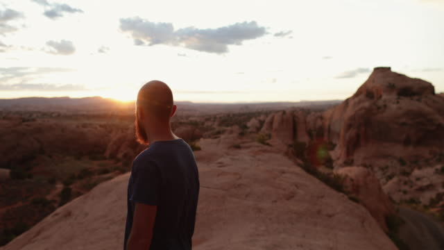 man enjoys nature in the southwest usa, moab - canyon stock videos & royalty-free footage