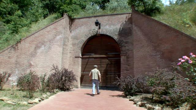 MS Man entering cellar / Siena, Tuscany, Italy