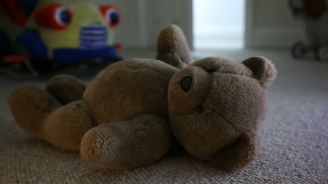 man entering child's room, teddy bear on the floor. - teddy bear stock videos and b-roll footage