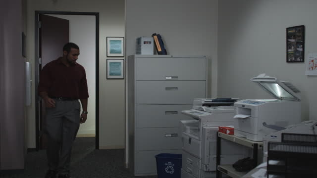 ms man entering copy room and holding up recycle bin, dallas, texas, usa - wastepaper bin stock videos & royalty-free footage