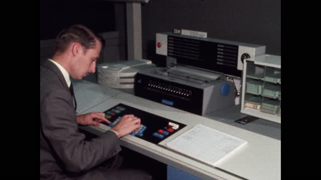 man entering data into ibm mainframe computer - file clerk stock videos & royalty-free footage