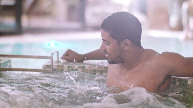 man entering hot tub at daily spa - spa stock videos & royalty-free footage